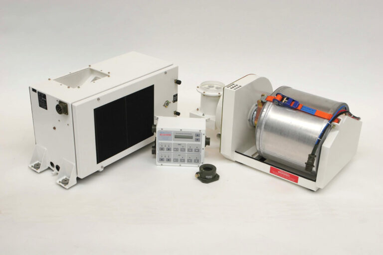A shot of multiple items including a completed fresh air filtration unit, a pressure valve and a crew cooling unit